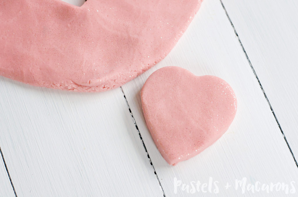 Strawberry Glitter Playdough is the softest homemade playdough and it smells amazing also! Make a big batch and use it to give away as nice little Valentine's gifts.