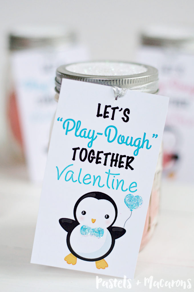 Kids Valentine Gift In A Mason Jar With Free Printable. Make this super easy and cute gift for the special kids in your life. All it takes it play dough, mason jar, glitter and your FREE printable gift tags to make this special Valentines Day gift .