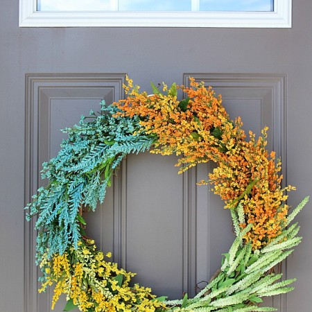 Learn to make this DIY Faux Wildflower Wreath without using glue or floral wire! It's SO easy to make!
