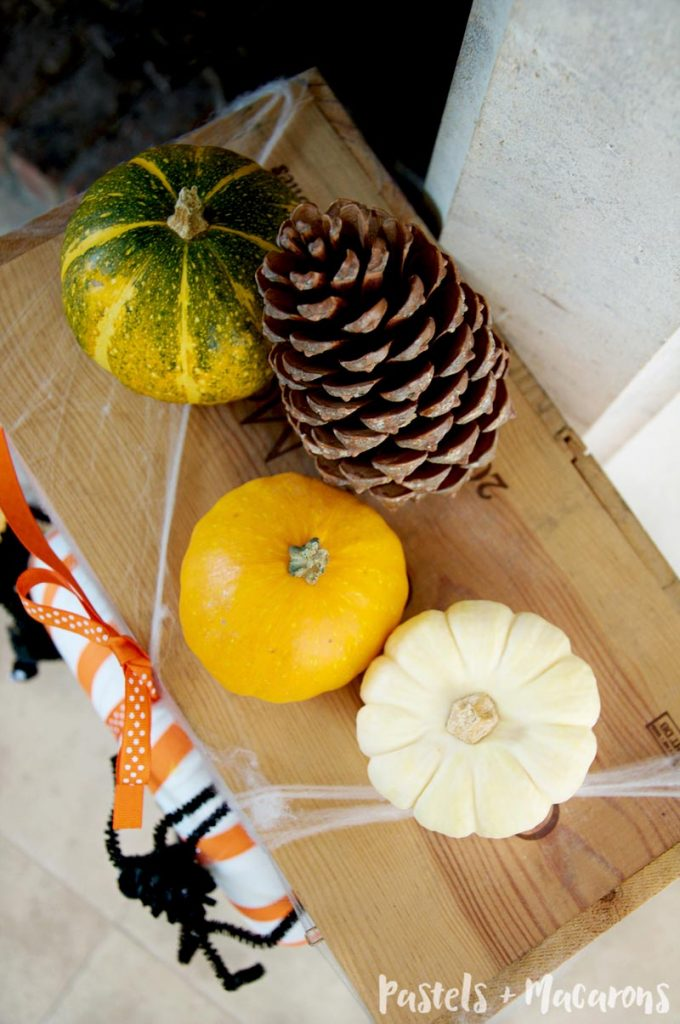 Use plenty of pumpkins and pinecones for your Halloween Mantel Decor