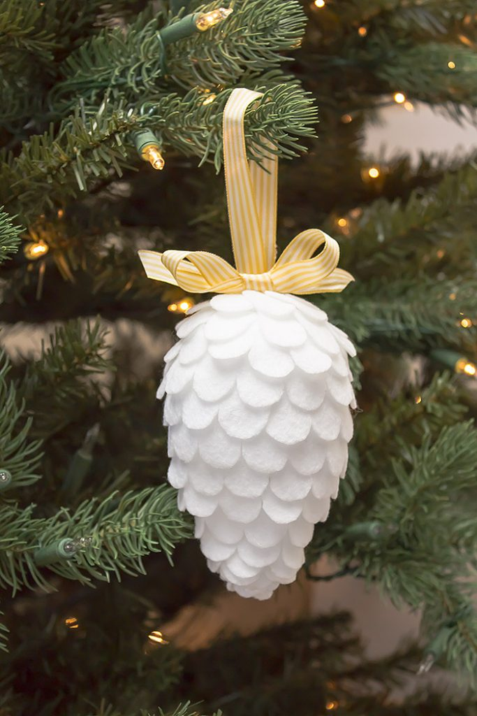 a beautiful faix pinecone christmas felt ornament craft for your christmas tree decor this is