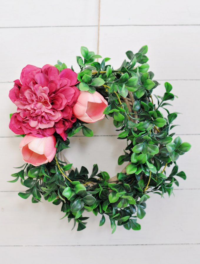 Easy 10 minute DIY Spring Wreath using flowers. This simple idea uses a no glue method and most supplies can be purchased at the dollar store.