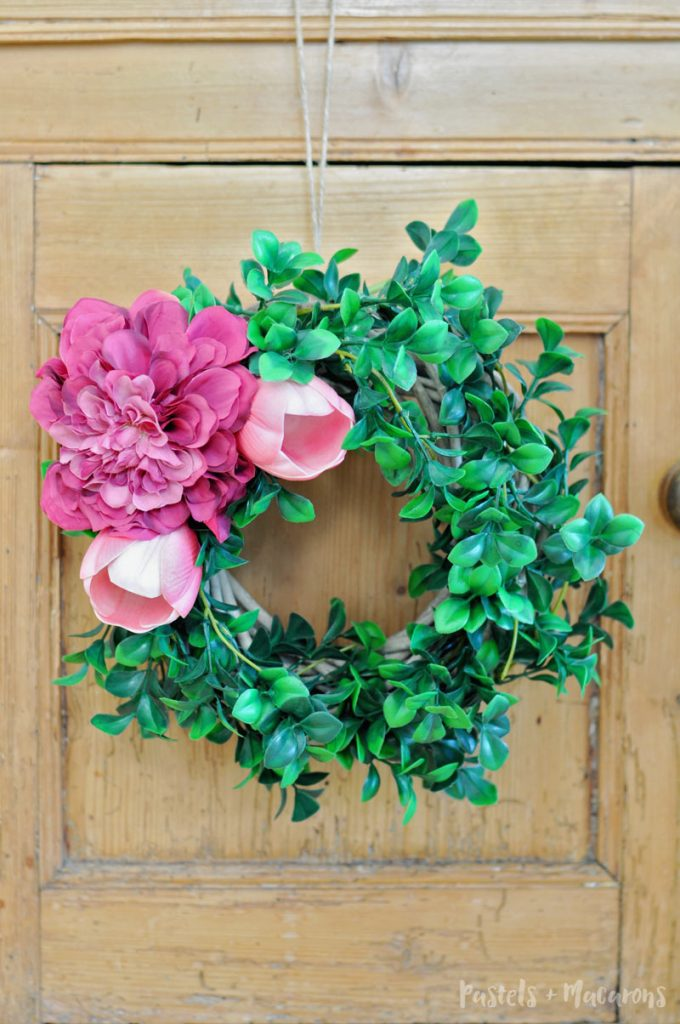 Spring Wreath using flowers and no glue needed. This easy and simple DIY tutorial will have you running to the dollar store. And it only takes 10 minutes to make!!