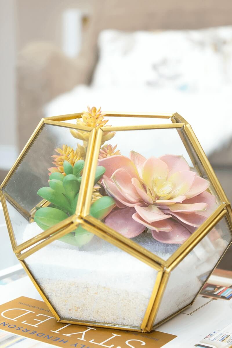 Make the perfect statement with this sweet little artificial succulent terrarium.