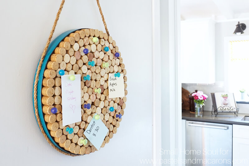 Hanging a DIY cork board in the kitchen keeps notes handy.