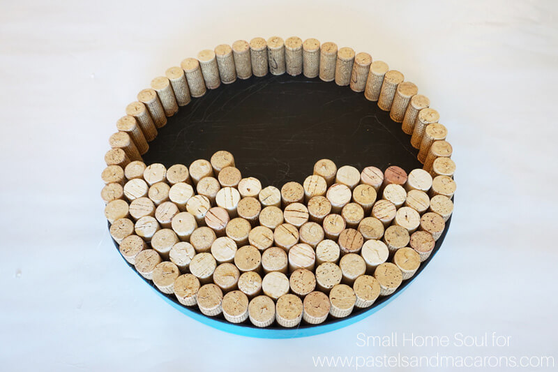 Use a glue gun to attach corks to your DIY Cork Board.