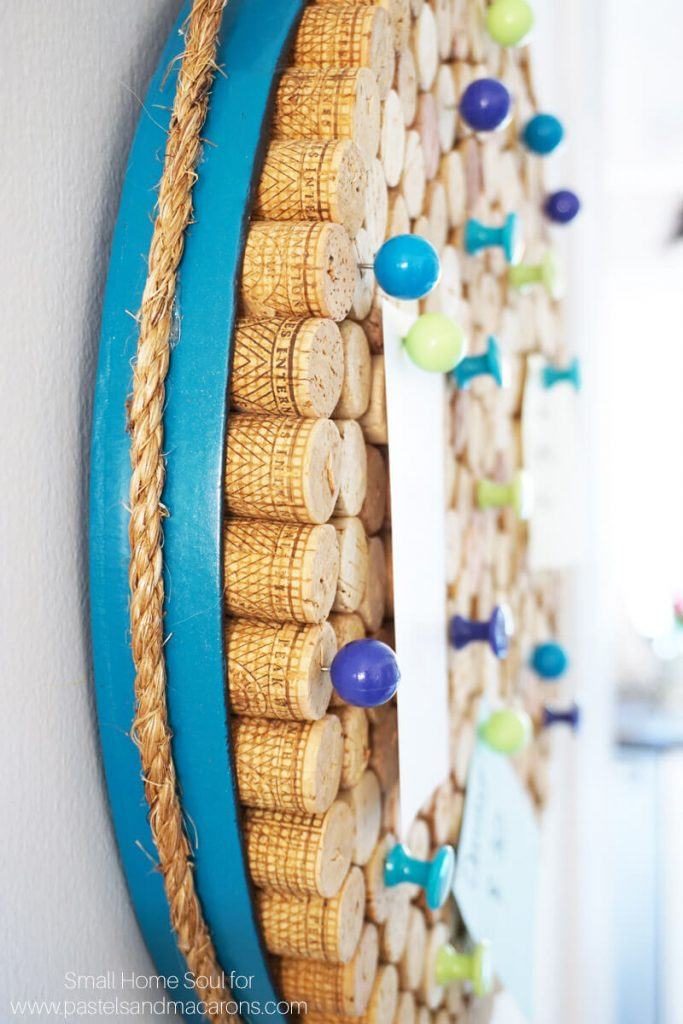A rope handle on your DIY cork board gives it a coastal vibe.