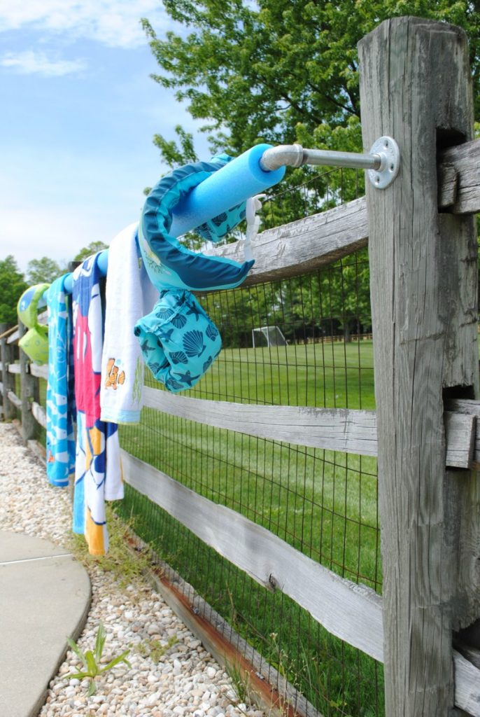 This DIY pool towel rack solves the problem of lacking a place to hang towels pool-side.