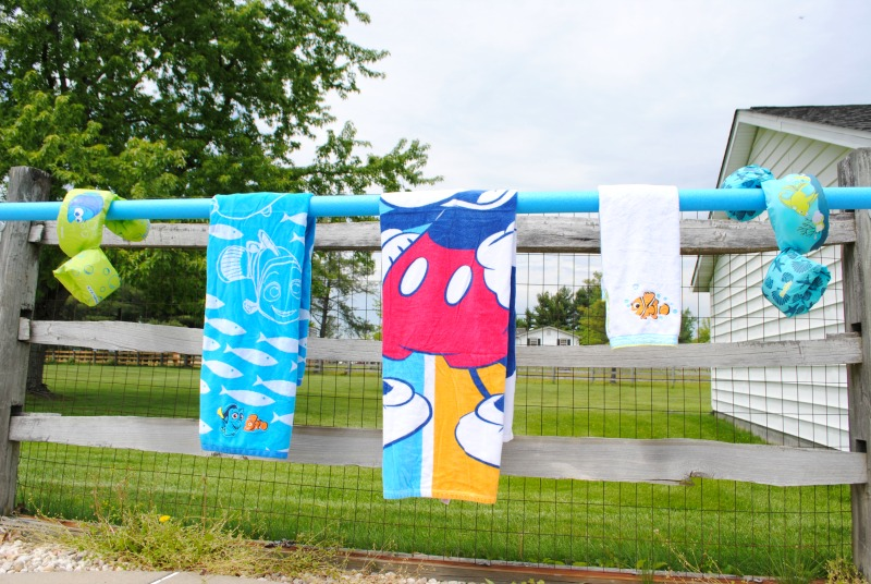 Hang towels, floaties, and bathing suit cover ups on this DIY pool towel rack.