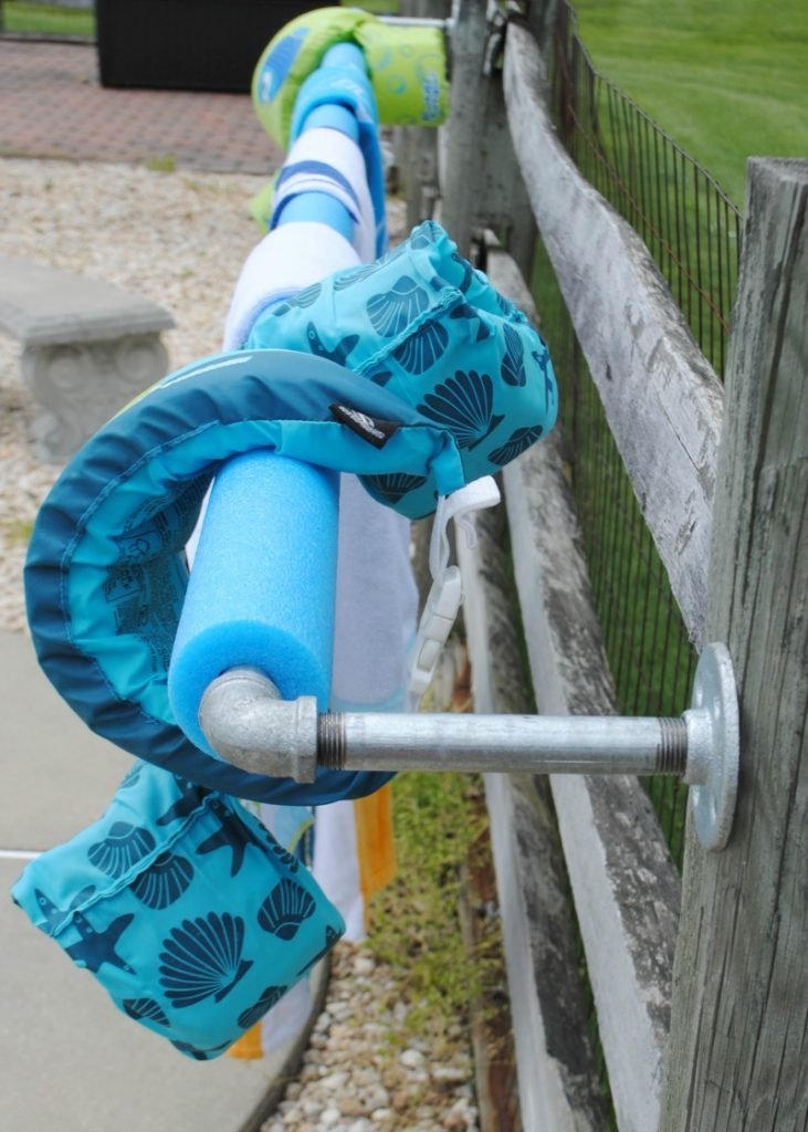 Need a place to dry your kids floaties? Make this easy DIY pool towel rack.