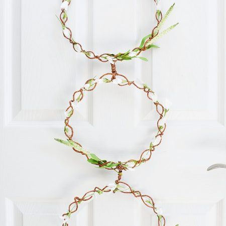 DIY Spring Door Wreath for farmhouse decor. Delicate with flowers and grapevine string.