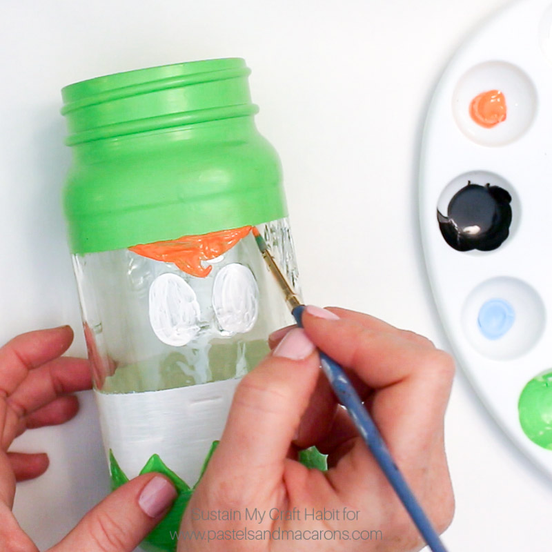 Painting hair onto the Mason Jar Elf- Painting blue eyes DIY mason jar craft- Mason Jar Christmas Gift