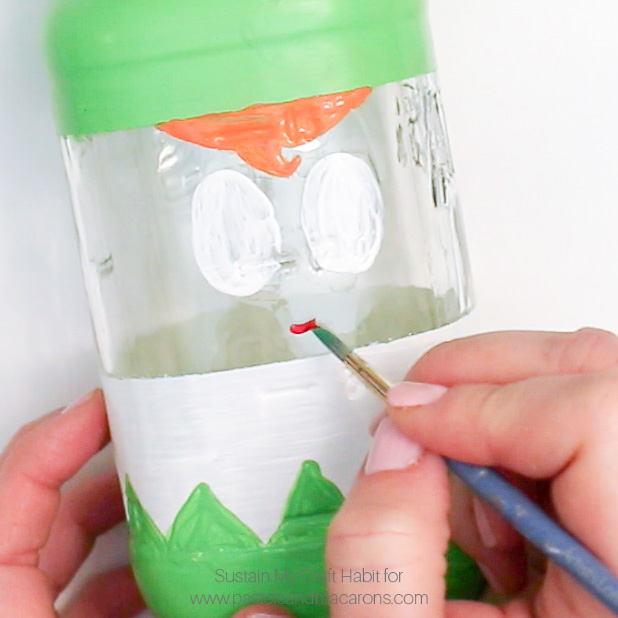 Painting a mouth onto a Mason Jar elf- Painting blue eyes DIY mason jar craft- Mason Jar Christmas Gift