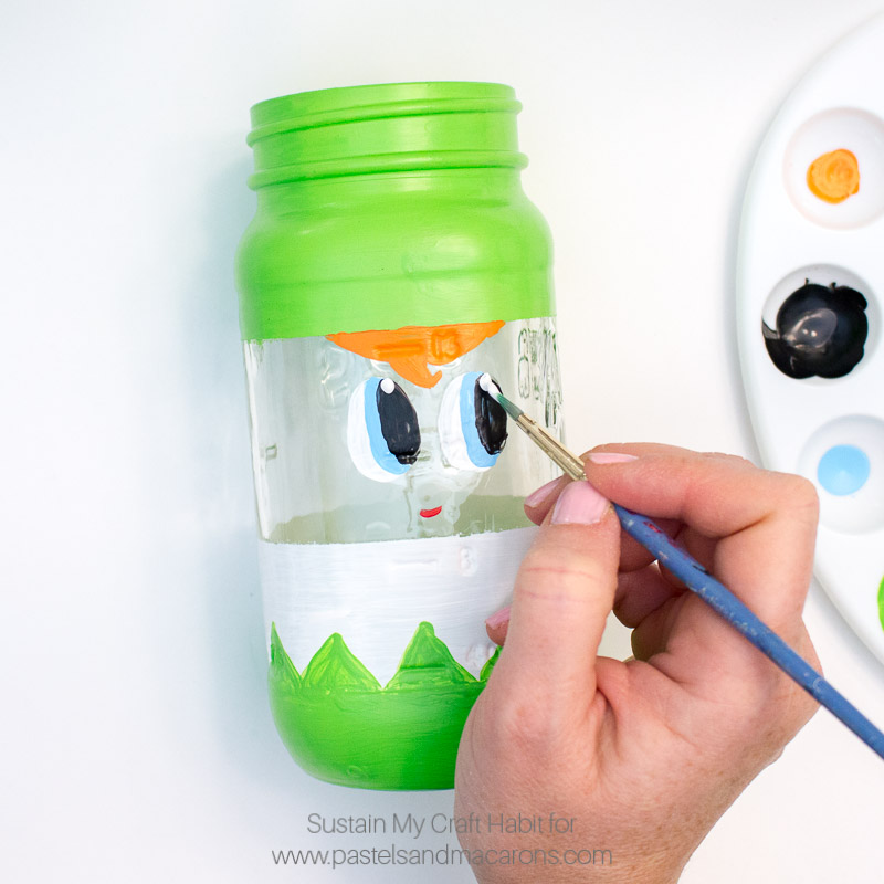 How SWEET is this Peak-a-boo Christmas Mason Jar craft ideas | Secret santa gift idea | Handmade holiday stocking stuffer- Painted Mason Jar Christmas Gift you can pop candy and treats into for the holidays. #masonjarcrafts #masonjarcraft #secretsanta #christmascraft #christmasgift #diygift #diychristmasgift