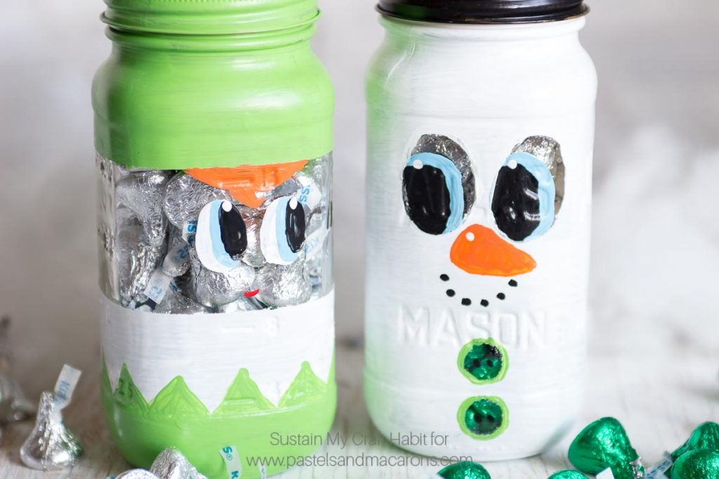 THE BEST DIY painted mason jar craft I have seen! This Mason Jar Christmas Gift is perfect to put candy and treats into for the Holidays. | Cute Christmas mason jar craft ideas | Secret Santa gift idea, Christmas Gift Idea, Teacher gift idea, stocking stuffer idea #masonjarcrafts #masonjarcraft #secretsanta #christmascraft #christmasgift #diygift #diychristmasgift #paintedmasonjar
